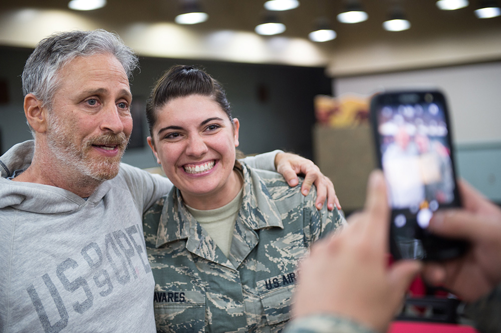 Jon Stewart Poses for Photo with Servicemember